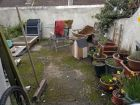 Cluttered, nasty back yard Brighton